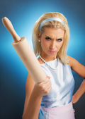 Angry housewife with rolling pin — Stock Photo