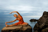 Beautiful woman doing yoga exercise — Foto de Stock