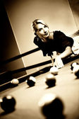 Beautiful woman playing billiards — Stock Photo