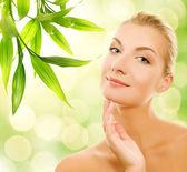 Young woman applying organic cosmetics — Stock Photo