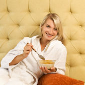Beautiful woman has breakfast in bed — Stock Photo