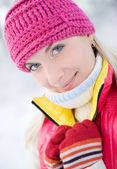 Beautiful young blond in winter forest — Stock Photo