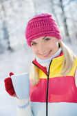Woman drinking hot tea outdoors — Stock Photo