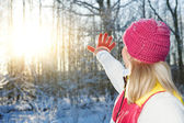 Young woman waving goodbye to winter — Stok fotoğraf