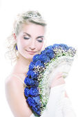 Bride hiding behind luxury bouquet — Stock Photo