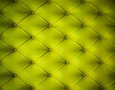 Green button-tufted leather background — Stock Photo