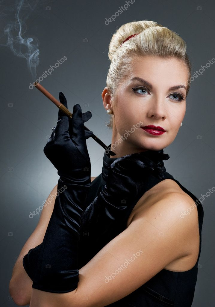 Charming lady smoking cigarette  Stock Photo #2082378
