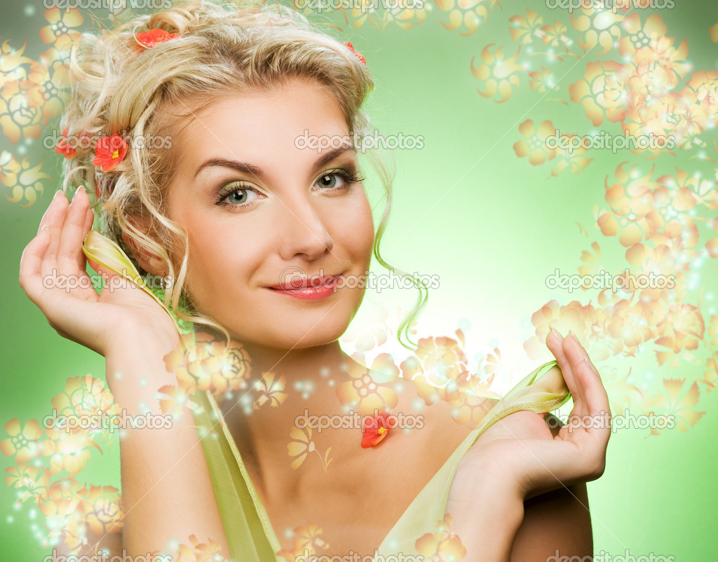 Beautiful young woman with fresh flowers in her hair. Spring concept.  Stock Photo #2082629