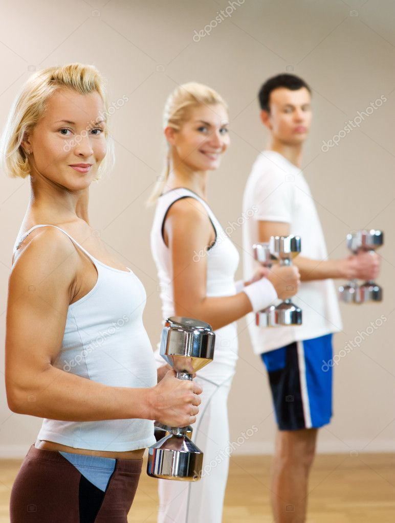 Group of doing fitness exercise with dumbbells — Stock Photo #2083766