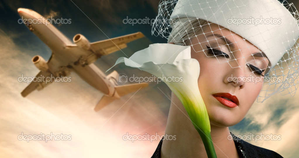 Sexy stewardess and flying plane  Stock Photo #2084271