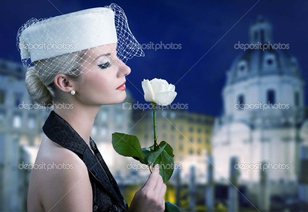Beautiful young woman with white rose — Stock Photo #2084336