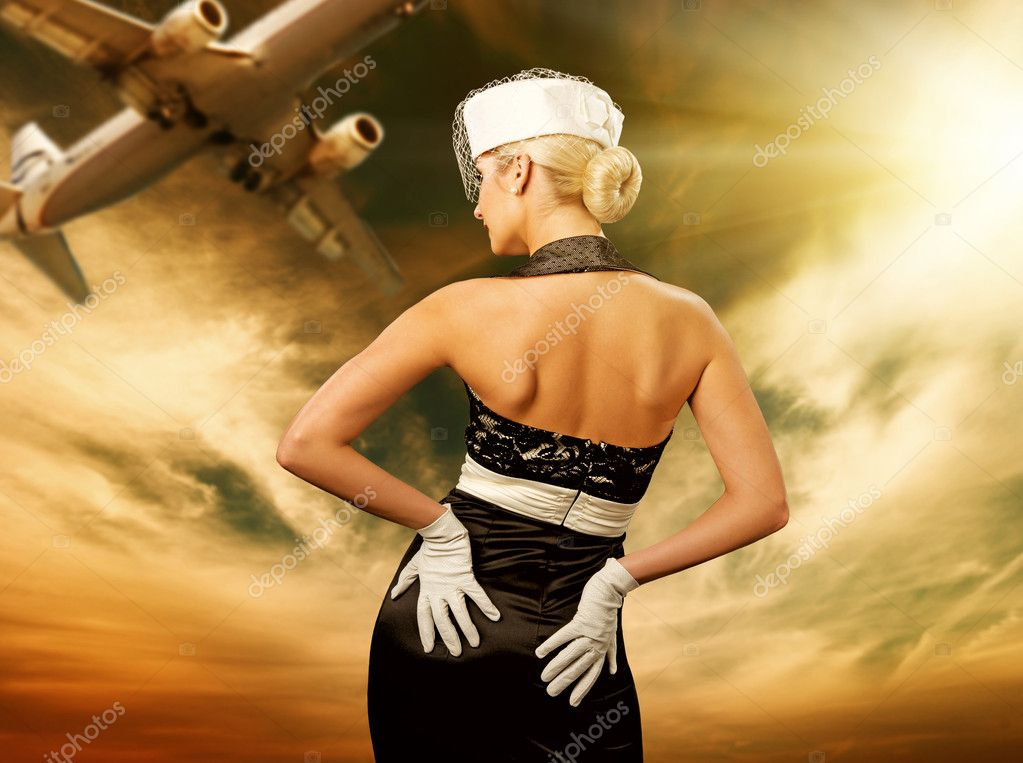 Sexy stewardess and flying plane — Stok fotoğraf #2084441