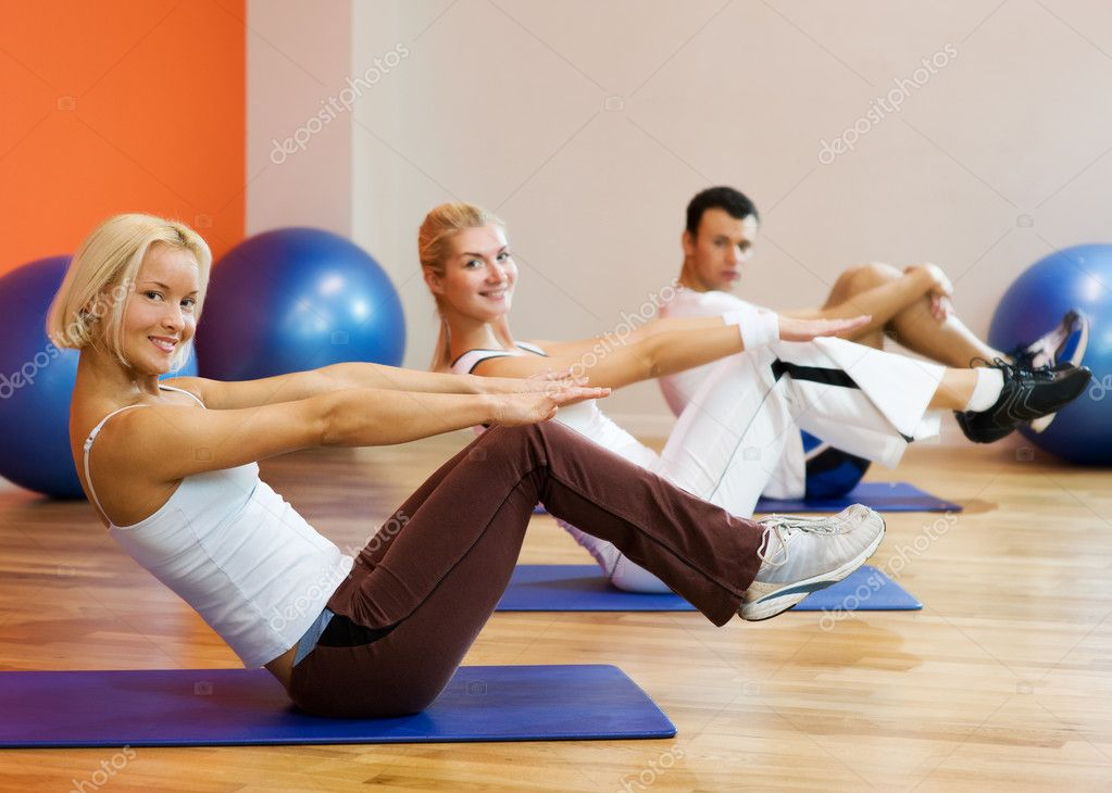 Group of doing fitness exercise — Stock Photo #2084478