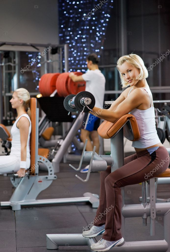 Strong beautiful woman lifting heavy weights  Stock Photo #2084932