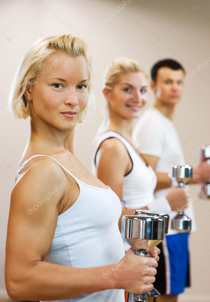 Group of doing fitness exercise with dumbbells — Stock Photo #2085124