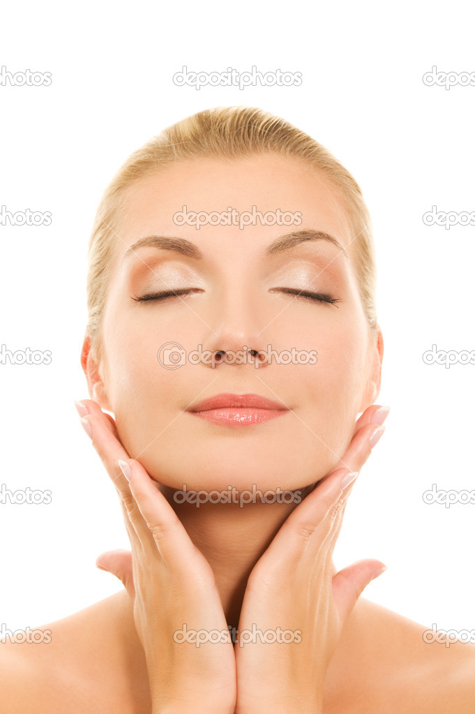 Beautiful young woman touching her face  Stock Photo #2085154