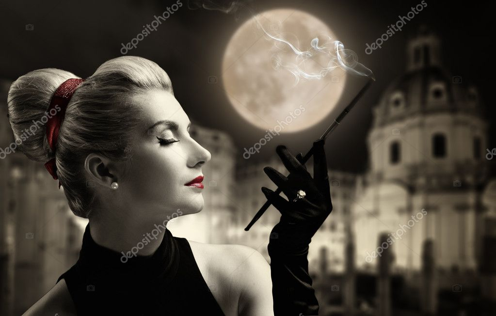 Beautiful young lady smoking. Old city behind her. — Stock Photo #2085245