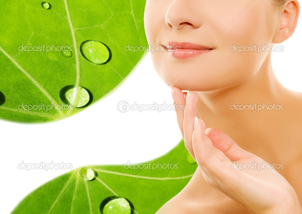 Beautiful young woman over green leaf background  Stock Photo #2085352