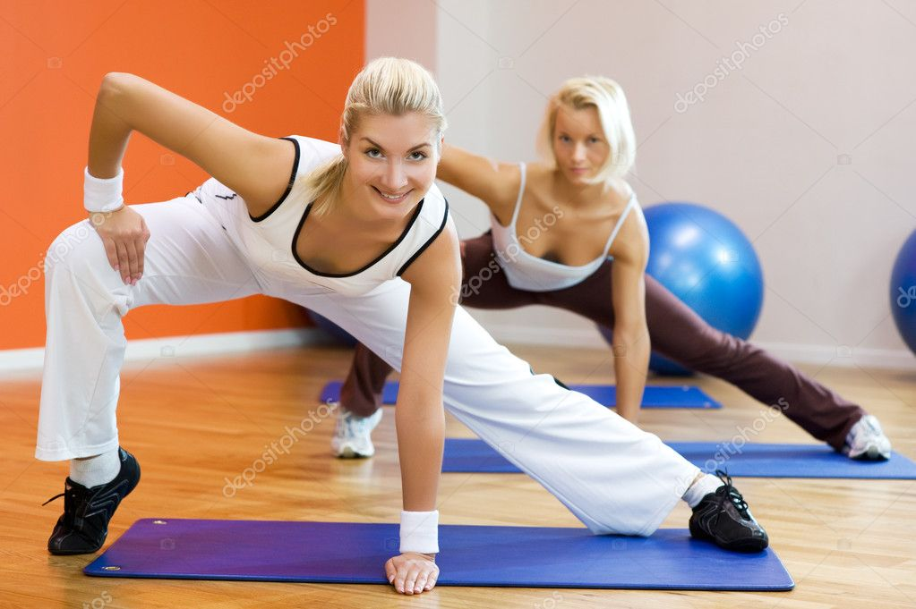 Group of doing fitness exercise — Stock Photo #2085937