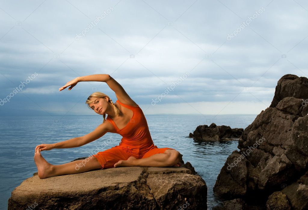 Beautiful young woman doing yoga exercise outdoors — Stock Photo #2086016
