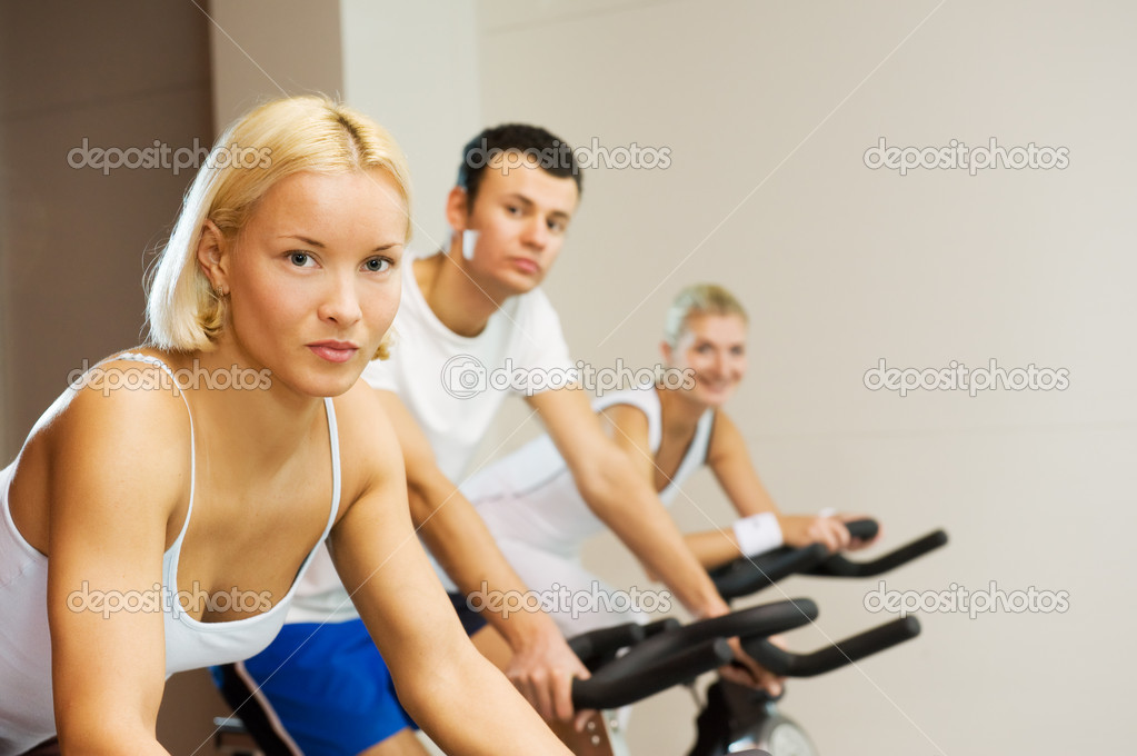 Group of doing exercise on a bike in a gym  Stock Photo #2086046