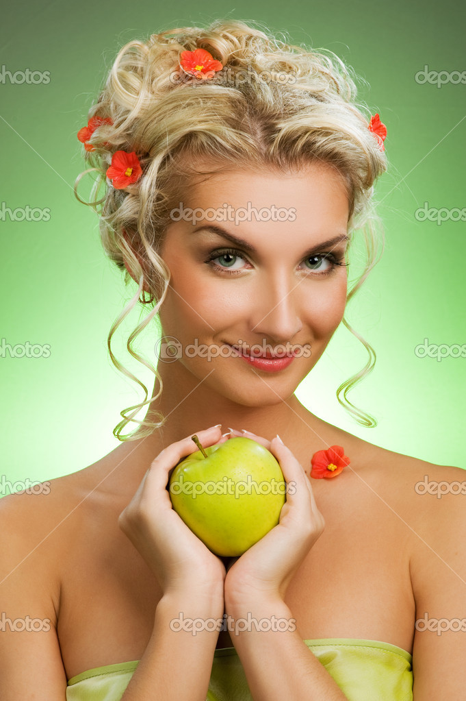Beautiful young woman with ripe green apple  Stock Photo #2086318