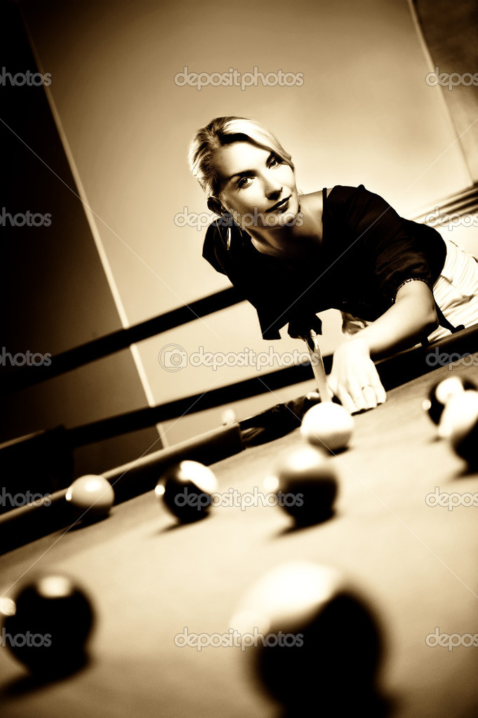 Beautiful blond woman playing billiards (toned in sepia) — Stock Photo #2086649