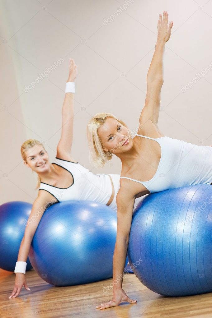Group of doing fitness exercise with a ball — Stock Photo #2086713