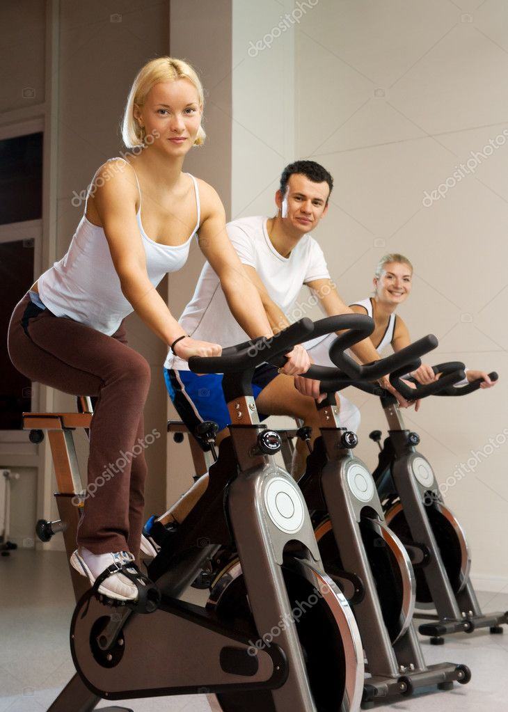 Group of doing exercise on a bike in a gym  Stock Photo #2086910