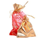 Gold and red gift bags — Stock Photo