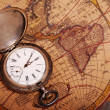 Pocket watch on antique map — Stok fotoğraf