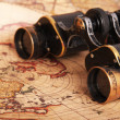 Royalty-Free Stock Photo: Old binoculars on antique map