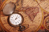 Pocket watch on antique map — Stock Photo