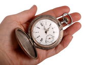 Hand shows antique pocket watch — Stock Photo
