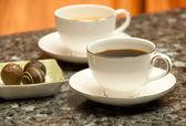 Coffee break with chocolates — Stock Photo