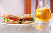Tuna sandwiches and iced tea — Stock Photo