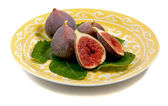 A plate figs on a fig leaf — Stock Photo