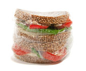 Plastic wrapped sandwich — Stock Photo