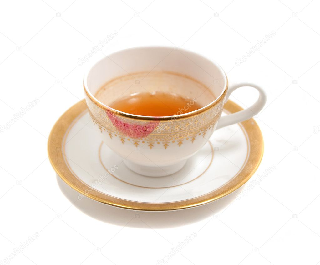 Stained teacup with lipstick smear isolated on white — Stock Photo #1867151