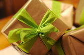 Gift boxes with lime green bow ties — Stock Photo