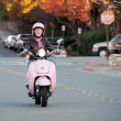 Lady biker on pink scooter — Stock Photo