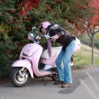 Woman turning on/off her motorbike — Stock Photo
