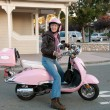 Sixty year old biker in town — Stockfoto