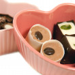 Stock Photo: Chocolate truffles in heart shaped dishe