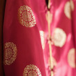 Chinese red silk jacket — Stock Photo #1910200