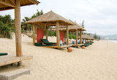 Cabanas on a sandy beach — Stock Photo