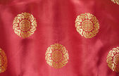 Red silk with gold embroidered brocade p — Stock Photo