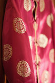 Chinese red silk jacket — Stock Photo