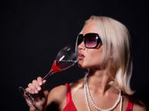 Attractive blond woman drinking cocktail — Stock Photo