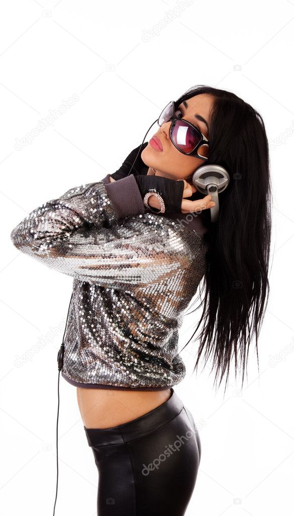 Picture of beautiful young woman holding headphones and listening music  Stock Photo #1451336